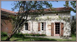 Maison en pierre MONTMOREAU SAINT CYBARD 80 m² ()