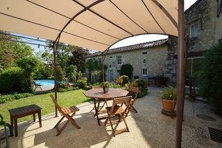 Maison en pierre LA ROMIEU 275 m² ()